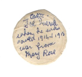 Reverse of Joe's Mary Rose penny, wife Nellie's notation